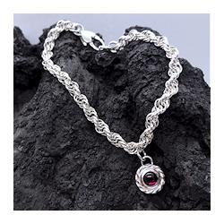 silver bracelet and garnet stone